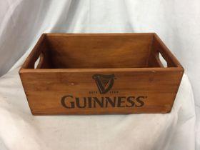 A WOODEN 'GUINNESS' BOX. LENGTH 33CM