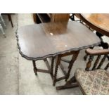 "AN EARLY 20TH CENTURY OAK GATELEG TABLE ON BARLEYTWIST LEGS, 22X35"" OPENED"