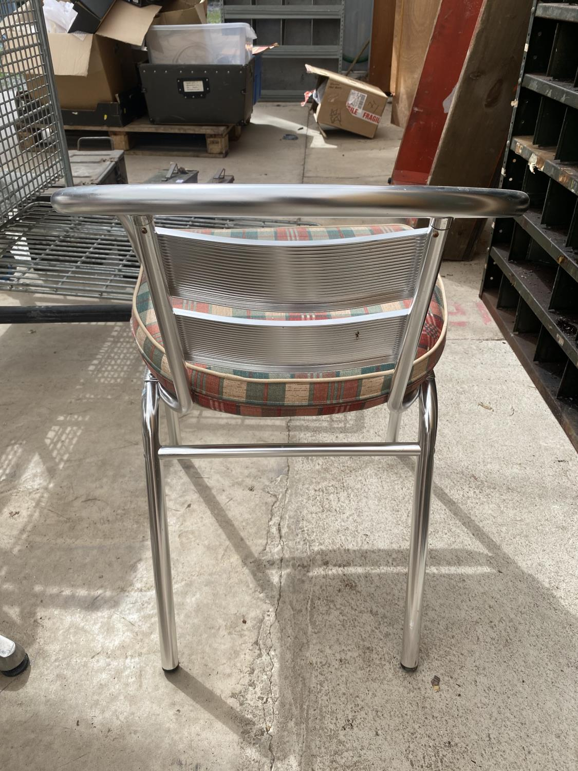 A STAINLESS STEEL BISTRO SET WITH ROUND TABLE AND FOUR CHAIRS - Image 4 of 5