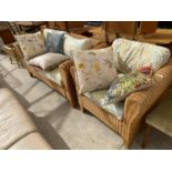 A MODERN WICKER CONSERVATORY SETTEE AND EASY CHAIR WITH FIVE LOOSE CUSHIONS