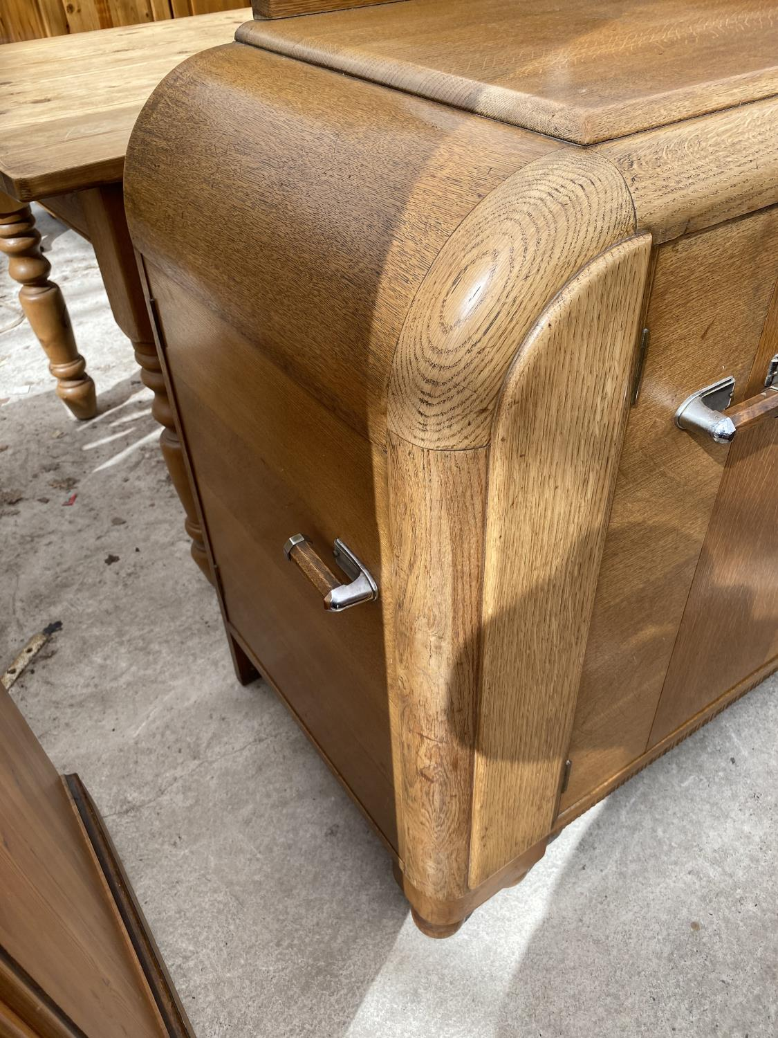 AN OAK E-GOMME SIDEBOARD DATED 1939 ENCLOSING CURVED END CUPBOARDS, TWO PAIRS OF CUPBOARDS WITH FOUR - Image 6 of 9