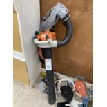 A STIHL SH56C LEAF BLOWER AND HOOVER WITH BAG