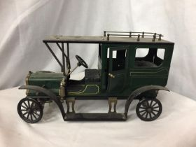 A VINTAGE STYLE MODEL GREEN MOTOR VEHICLE