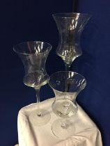 THREE LARGE GLASS CANDLE HOLDERS APPROXIMATE HEIGHTS 70CM 55CM 40CM