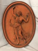 A TERRACOTTA PLAQUE OF A ROMAN SOLDIER