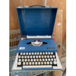 AN IMPERIAL 220 TYPE WRITER WITH CASE