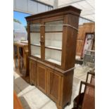 AN OAK BOOKCASE CABINET WITH TWO UPPER GLAZED DOORS AND THREE LOWER DOORS