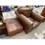 A MODERN LEATHER EASY CHAIR ON BUN FEET AND FOOTSTOOL WITH HINGED LID