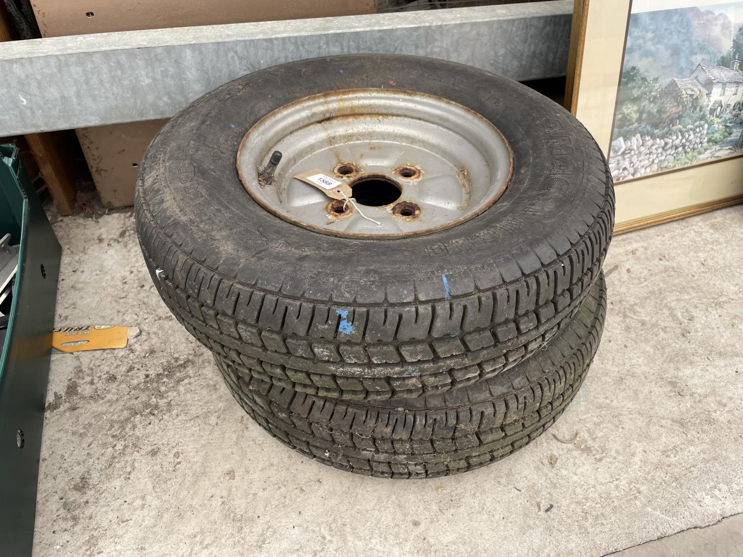 A PAIR OF FOUR STUDDED RIMS WITH TYRES