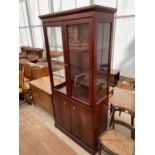 """A STAG TWO DOOR GLAZED BOOKCASE ON BASE, 36"""" WIDE"""
