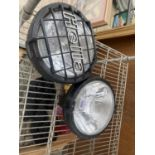 A PAIR OF LARGE CAR HEAD LAMPS TO INCLUDE A 'HELLA'