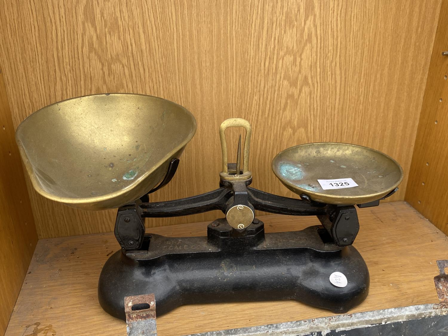A PAIR OF BRASS KITCHEN SCALES
