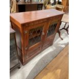"""A STANLEY WOOD OAK GLAZED AND LEADED BOOKCASE WITH CUPBOARDS TO THE BASE, 42"""" WIDE"""