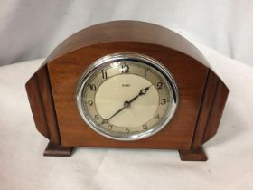 AN EIGHT DAY MANTLE CLOCK