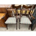 A PAIR OF REGENCY STYLE ELBOW CHAIRS