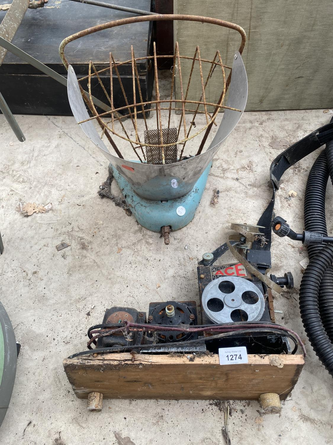 A VINTAGE MOTOR AND A VINTAGE PARAFIN HEATER