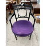 AN ARTS & CRAFTS BLACK PAINTED ELBOW CHAIR A/F