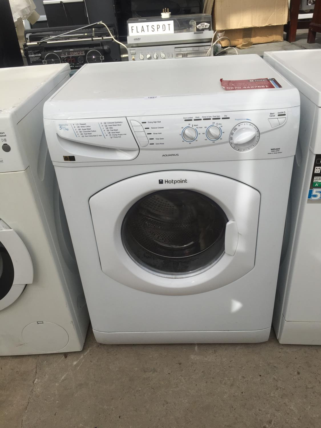 A WHITE HOTPOINT WASHER DRYER BELIEVED IN WORKING ORDER BUT NO WARRANTY