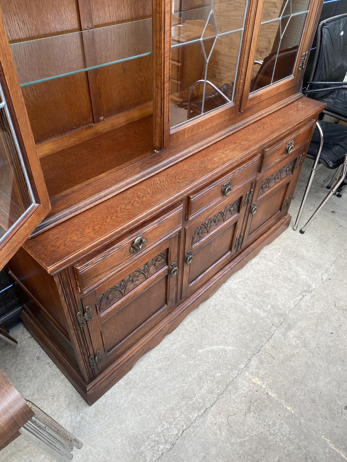 AN OAK OLD CHARM GLAZED AND LEADED CABINET ON BASE ENCLOSING THREE DRAWERS AND THREE CUPBOARDS, 52. - Image 5 of 5