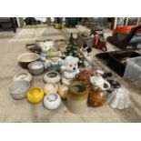 A LARGE ASSORTMENT OF CERAMIC WARE TO INCLUDE BISCUIT BARRELS, TEAPOTS AND LAMPS ETC