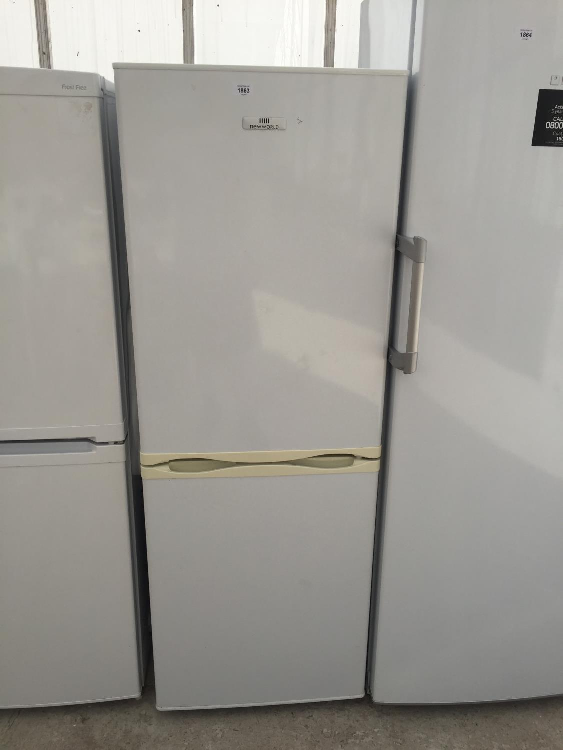 A WHITE NEWWORLD UPRIGHT FRIDGE FREEZER BELIEVED IN WORKING ORDER BUT NO WARRANTY - Image 2 of 4