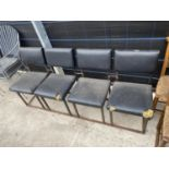 A SET OF FOUR JOINED CHAIRS ON BOX METAL FRAME