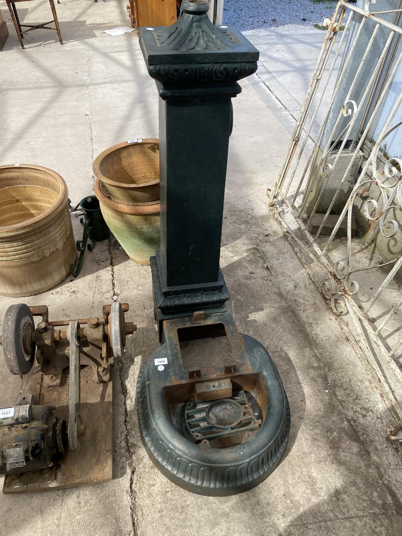 A VINTAGE CAST IRON WATER PUMP