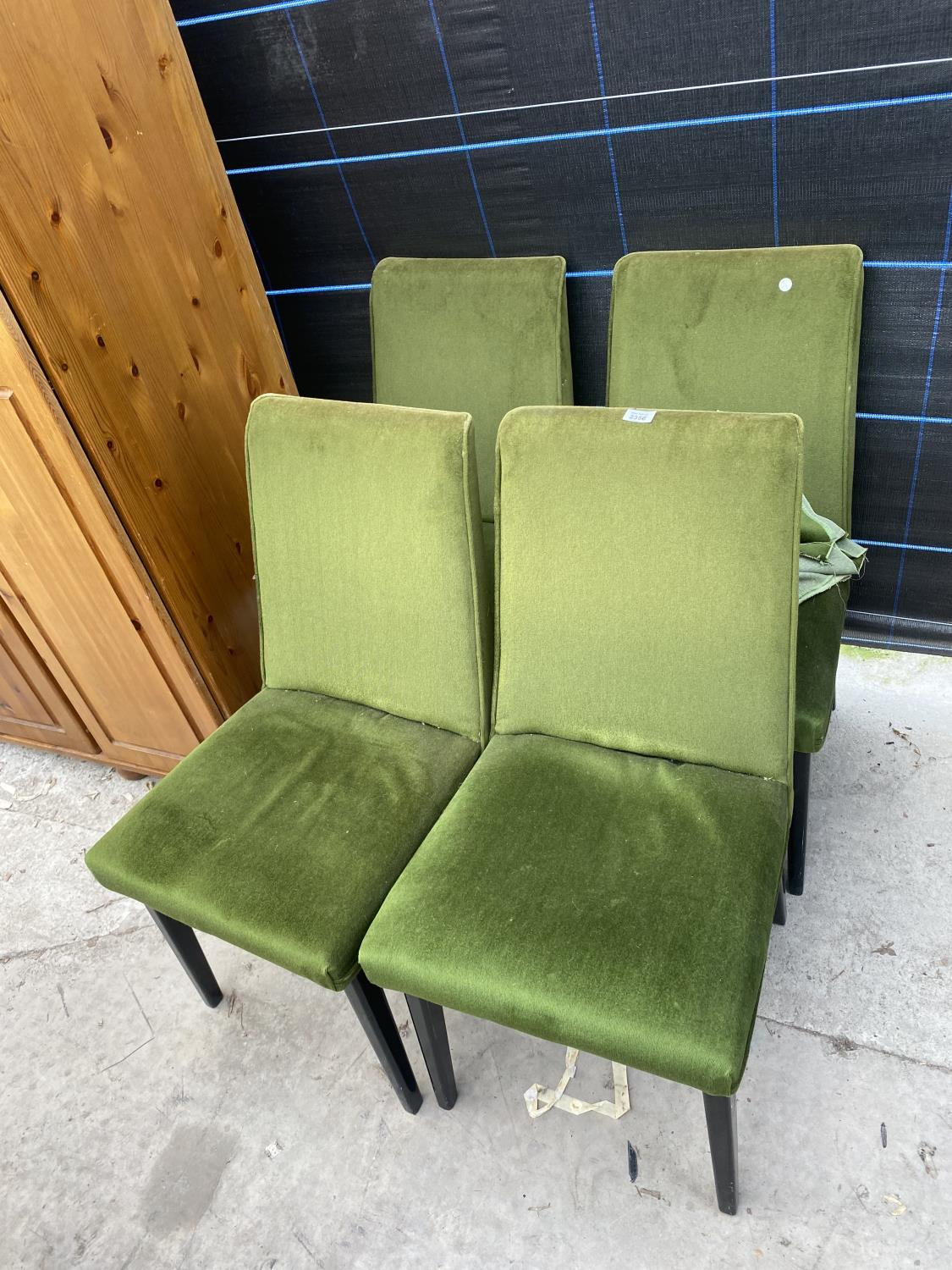 FOUR MID 20TH CENTURY DINING CHAIRS WITH GREEN UPHOLSTERED AND BLACK PAINTED LEGS