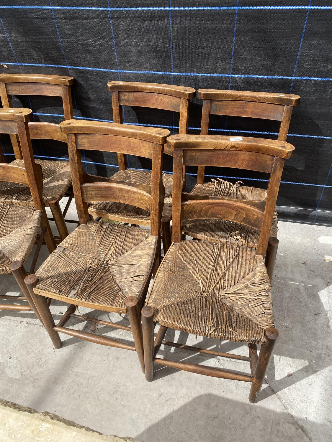 FOUR BEECH FRAMED CHAPEL CHAIRS WITH RUSH SEATS