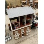 A VINATGE DOLLS HOUSE WITH AN ASSORTMENT OF DOLLS FURNITURE