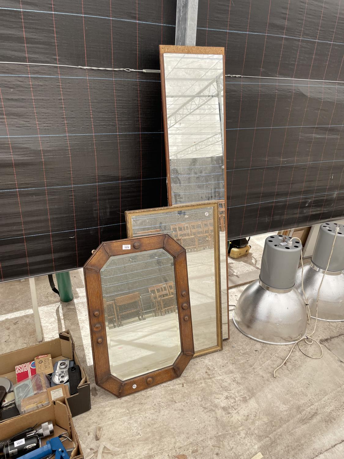 A GILT FRAMED MIRROR AND A FURTHER DECORATIVE WOODEN FRAMED BEVELED EDGE MIRROR AND A FULL LENGTH