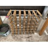 A WOODEN AND METAL BANDED WINE RACK