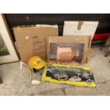 AN ASSORTMENT OF MODEL MAKING KITS AND A HELMET