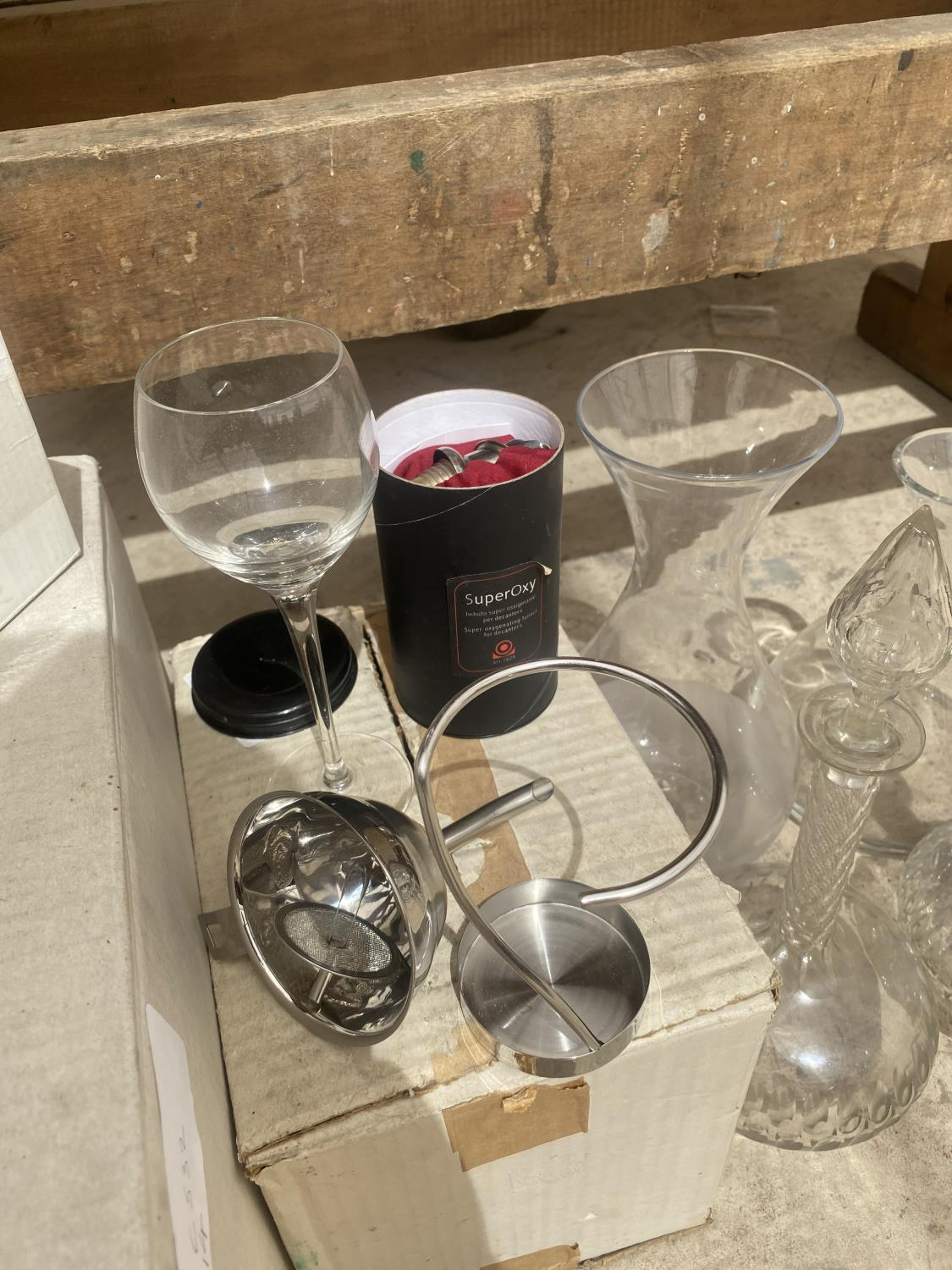 AN ASSORTMENT OF GLASS ITEMS TO INCLUDE VASES AND TWO DECANTORS ETC - Image 3 of 4