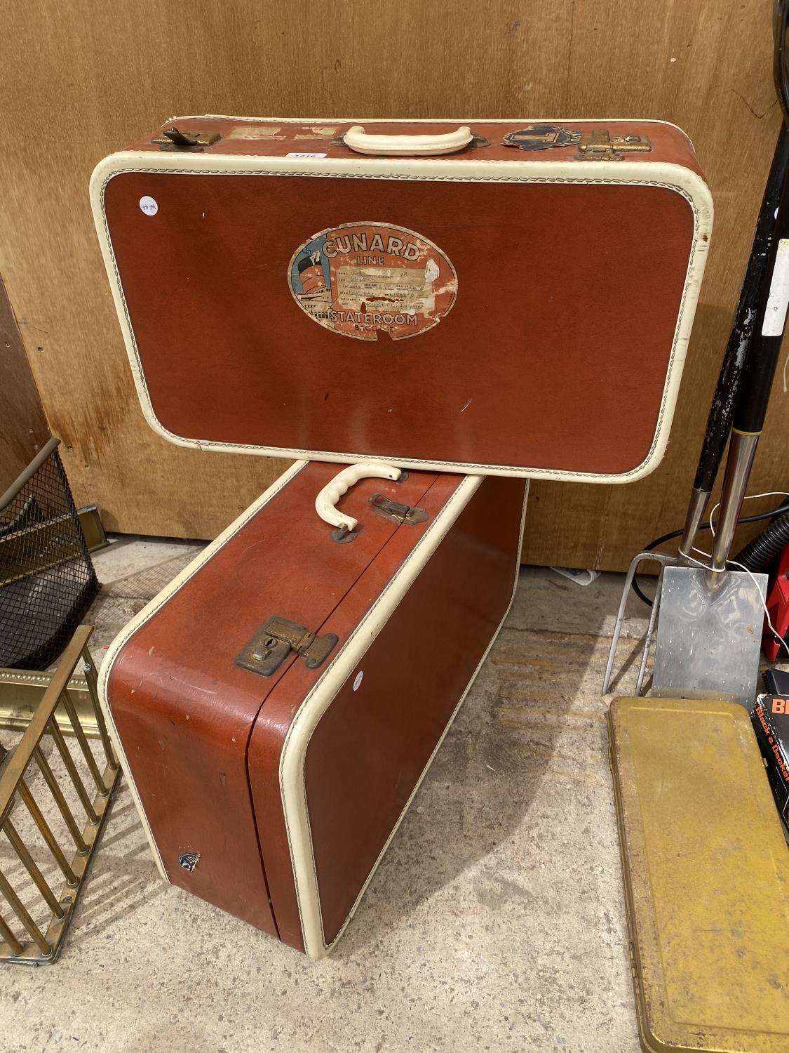 A PAIR OF VINTAGE LEATHER TRAVEL CASES