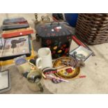 AN ASSORTMENT OF ITEMS TO INCLUDE JUGS, WOODEN SPOONS AND A BREAD BIN ETC