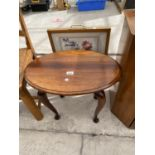 AN OVAL WALNUT OCCASIONAL TABLE AND FIRESCREEN