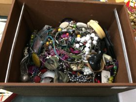 A LARGE BOX OF COSTUME JEWELLERY