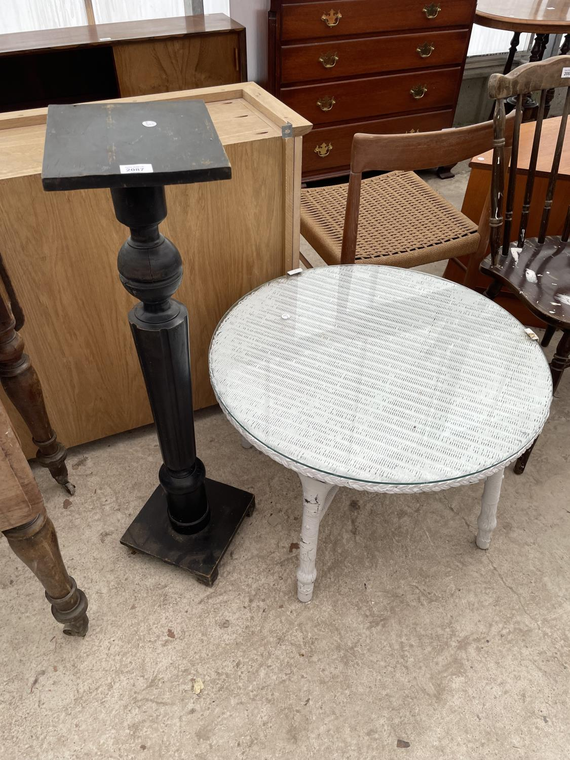 """A LOW LLOYD LOOM TABLE, 27"""" DIAMETER, WITH GLASS TOP AND EBONISED JARDINIER STAND"""