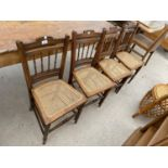 A SET OF FOUR EDWARDIAN BEDROOM CHAIRS WITH CANE SEATS