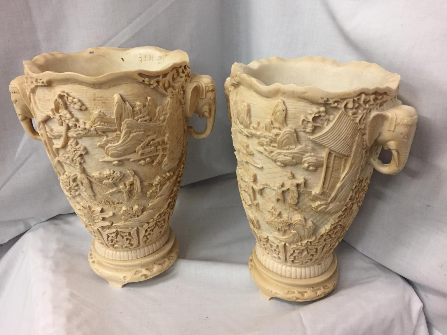A PAIR OF HEAVILY CARVED ORIENTAL VASES WITH ELEPHANT DESIGN TWIN HANDLES 30CM HIGH - Image 4 of 6