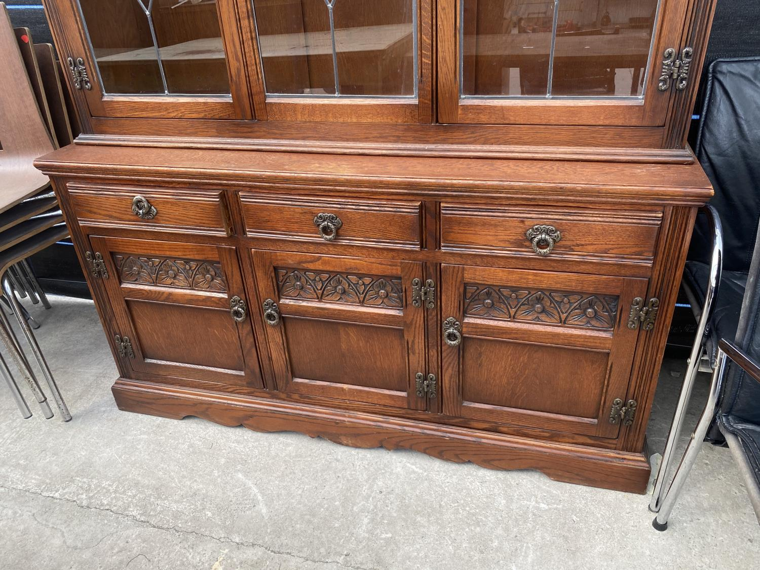 AN OAK OLD CHARM GLAZED AND LEADED CABINET ON BASE ENCLOSING THREE DRAWERS AND THREE CUPBOARDS, 52. - Image 2 of 5