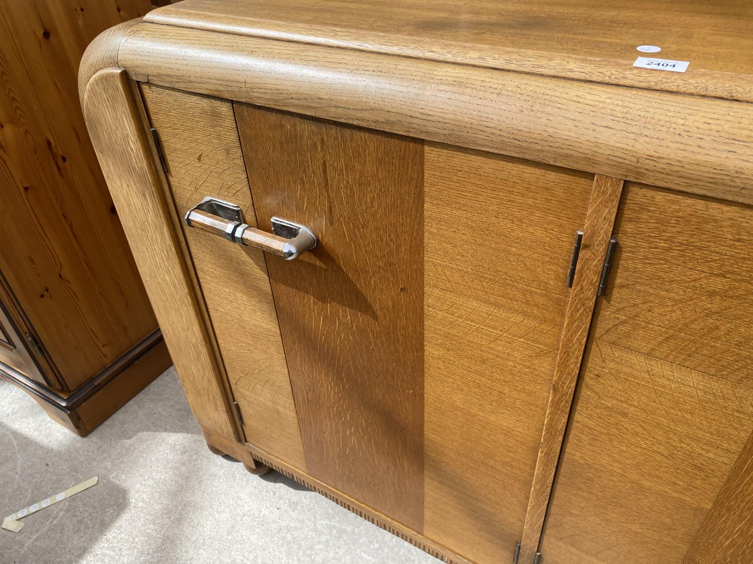 AN OAK E-GOMME SIDEBOARD DATED 1939 ENCLOSING CURVED END CUPBOARDS, TWO PAIRS OF CUPBOARDS WITH FOUR - Image 5 of 9