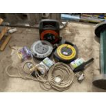 AN ASSORTMENT OF EXTENSION LEADS AND LIGHT BULBS ETC