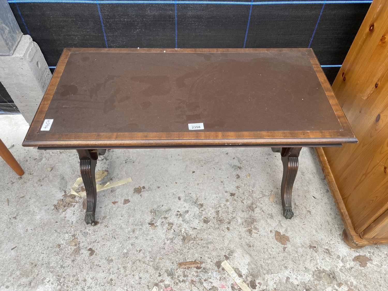 A REPRODUCTIION MAHOGANY COFFEE TABLE