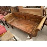 """A REGENCY STYLE HARDWOOD SCROLL END COUCH ON TURNED AND FLUTED LEGS, 66"""" WIDE"""