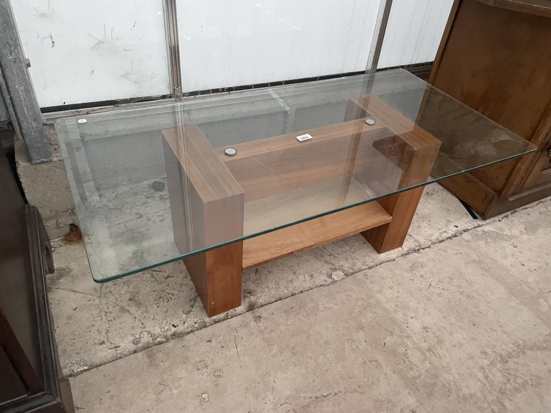 "A MODERN GLASS TOP COFFEE TABLE, 43X22"""
