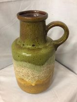 A LARGE WEST GERMAN POTTERY HANDLED VASE HEIGHT 39CM