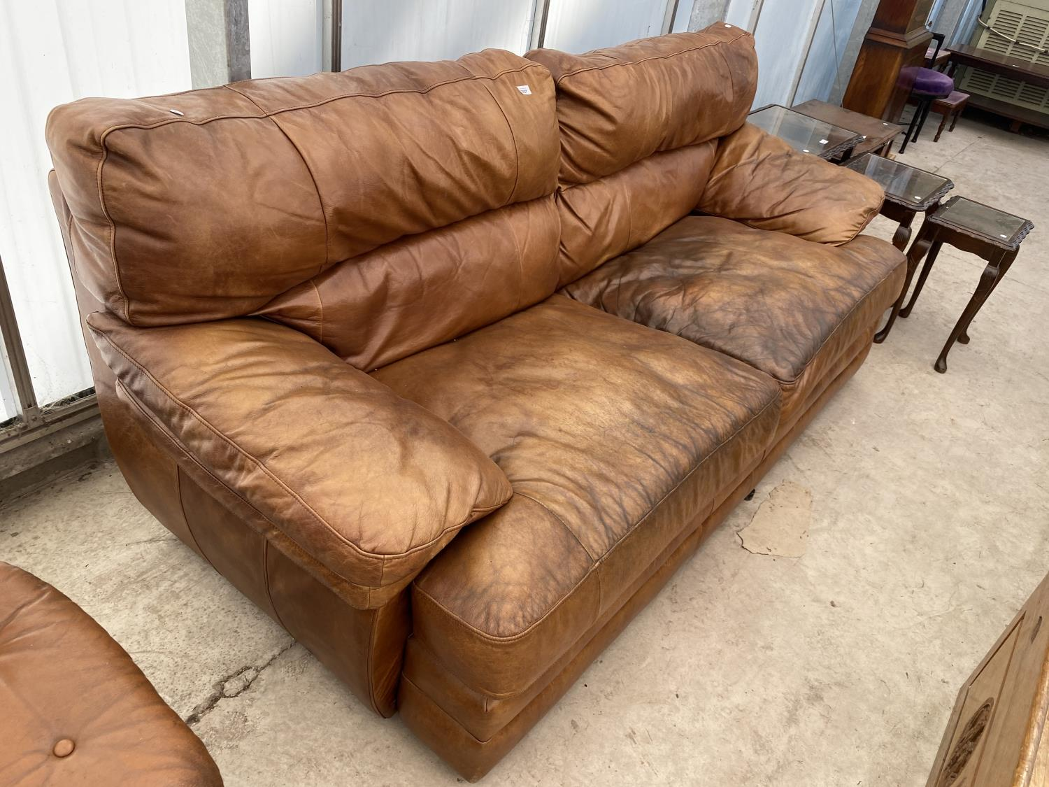 A MODERN LEATHER THREE SEATER SETTEE