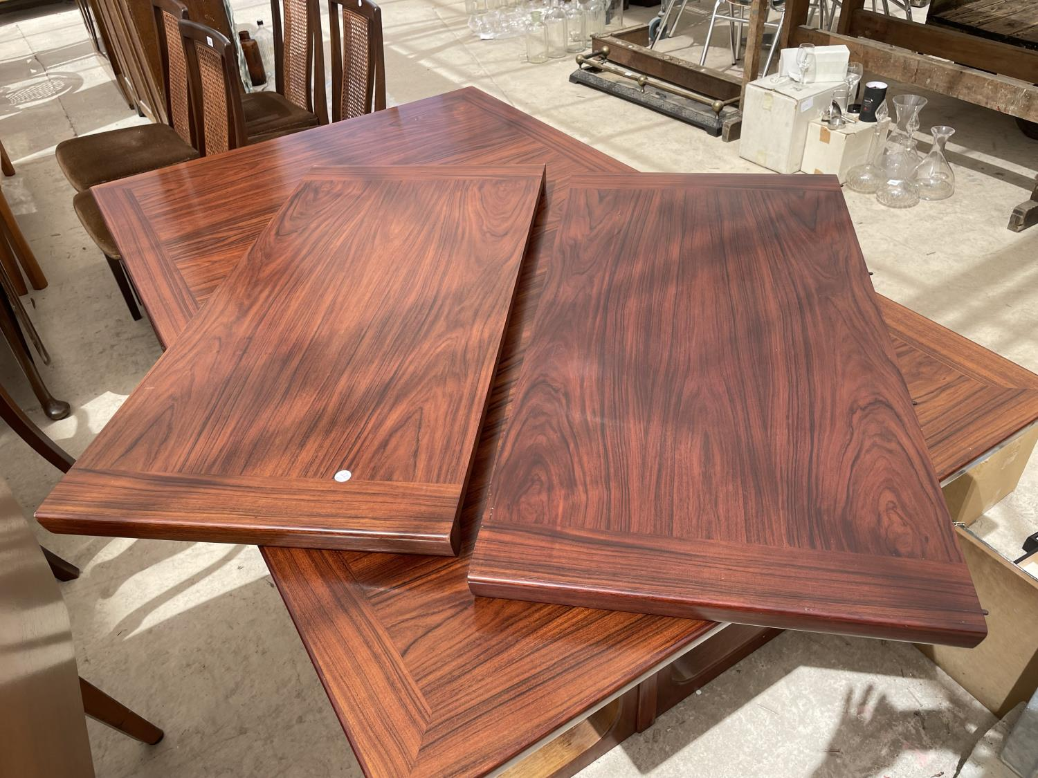 A RETRO EXTENDING HARDWOOD DINING TABLE WITH TWO EXTRA LEAVES - Image 6 of 6